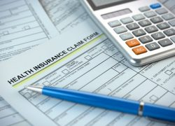 picture of health insurance claim forms and calculator