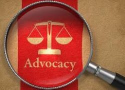 "Microscope focused on legal scale and the word ""advocacy"""