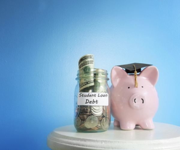 Piggy bank with a graduation cap sitting next to money in a jar. Automatic Student Loan Forgiveness for People with Disabilities