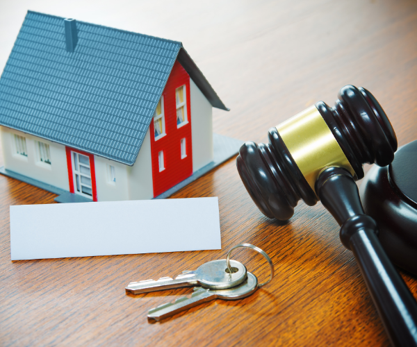 Urgent update for renters. House, keys, and gavel.
